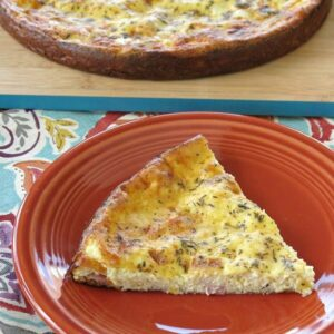 Slice of crustless quiche on plate