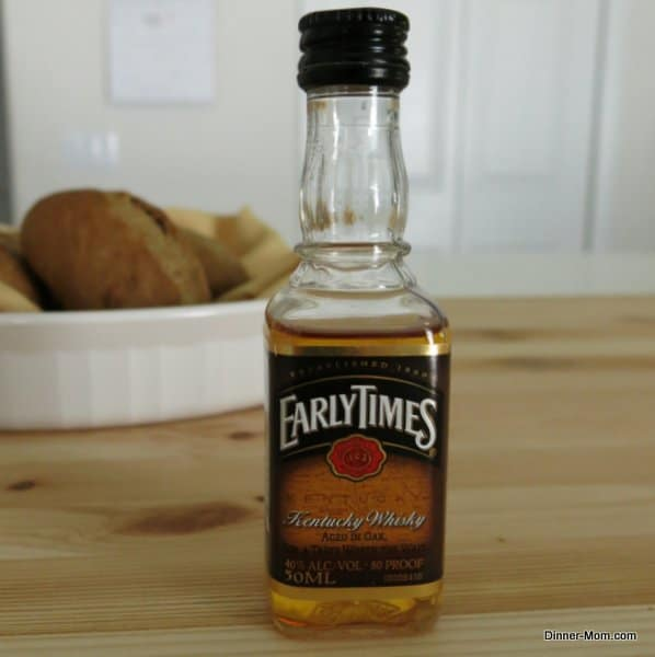 Small bottle of Kentucky whisky on table.