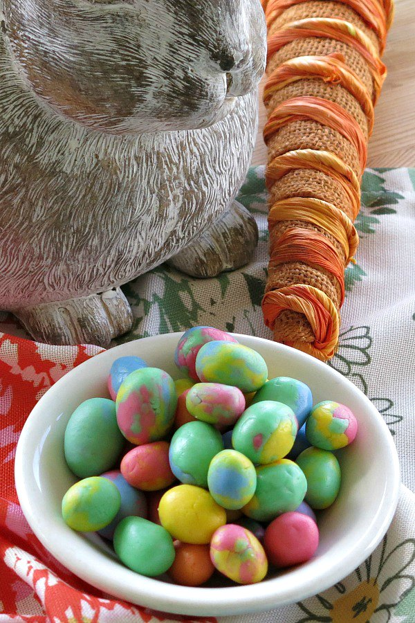 DIY Easter Egg Buttermints in a bowl with bunny and carrot in the background