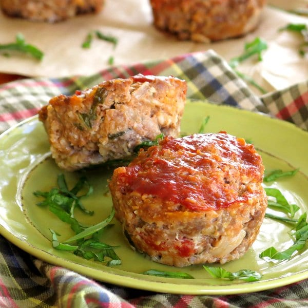 2 Gourmet Meatloaf Muffins with Mozzarella and Sundried Tomatoes on a plate