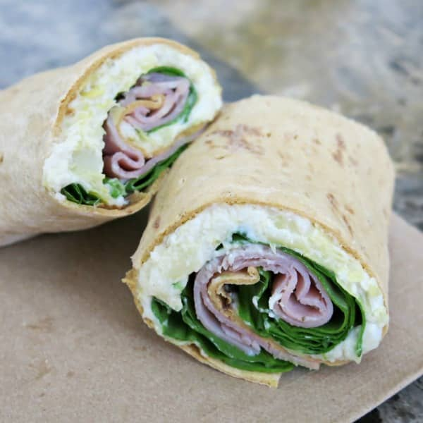 Sandwich wrap with warm artichoke dip, ham and spinach