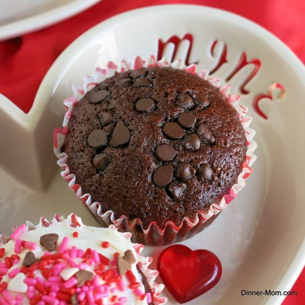 Vegan Chocolate Cupcake topped with chocolate chips on valentine plate