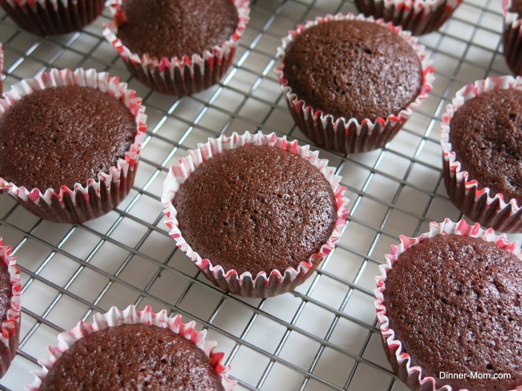 vegan chocolate cupcakes cooling on rack