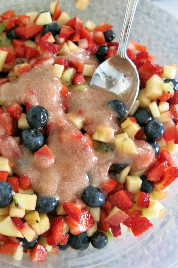 Fruit salsa in bowl with jam and stevia glaze drizzled on top.