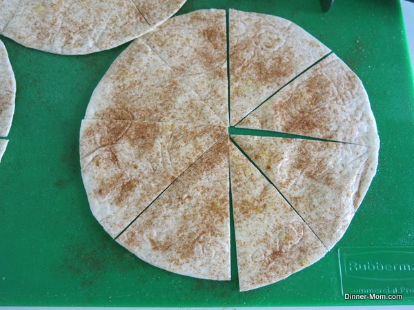Flour tortilla sprinkled with cinnamon and stevia sugar blend on cutting board