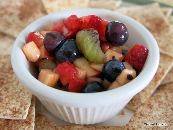Fruit Salsa in single serve bowl with Cinnamon Chips around it