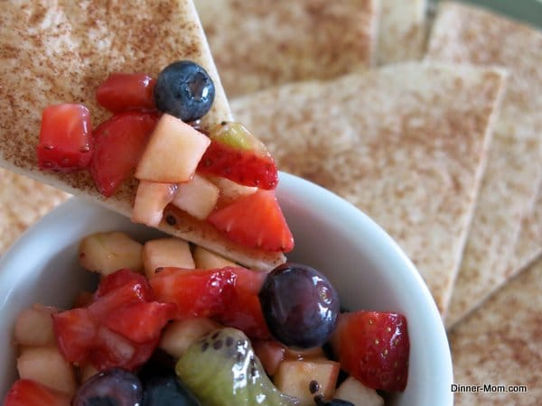 Cinnamon Chip dipping into bowl with Fruit Salsa