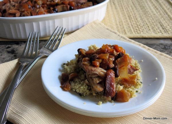 Chicken Tagine on a plate with 2 forks next to it