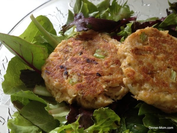 Maryland Style Lump Crab Cakes over Greens in bowl