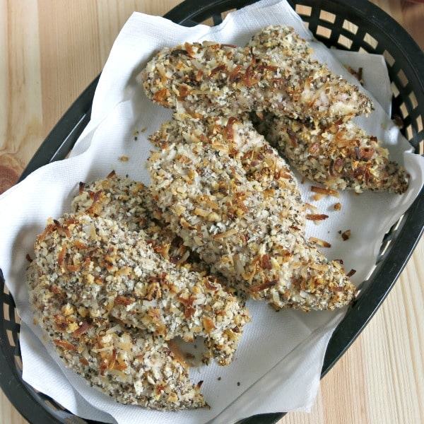 Oven baked chicken tenders with coconut and pecan in a basket