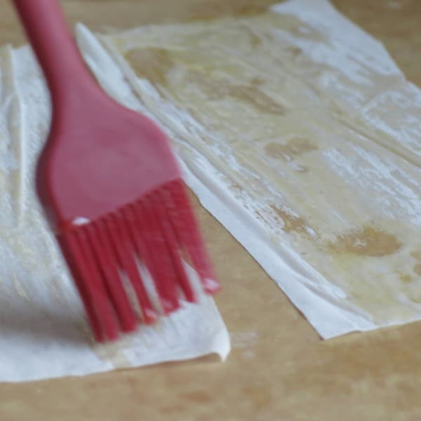 Phyllo Dough being brushed with butter