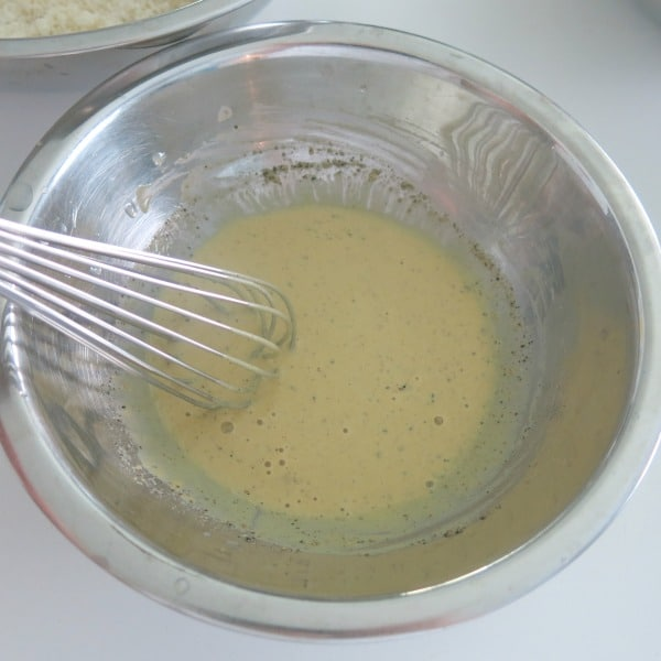 mustard sauce in bowl with whisk