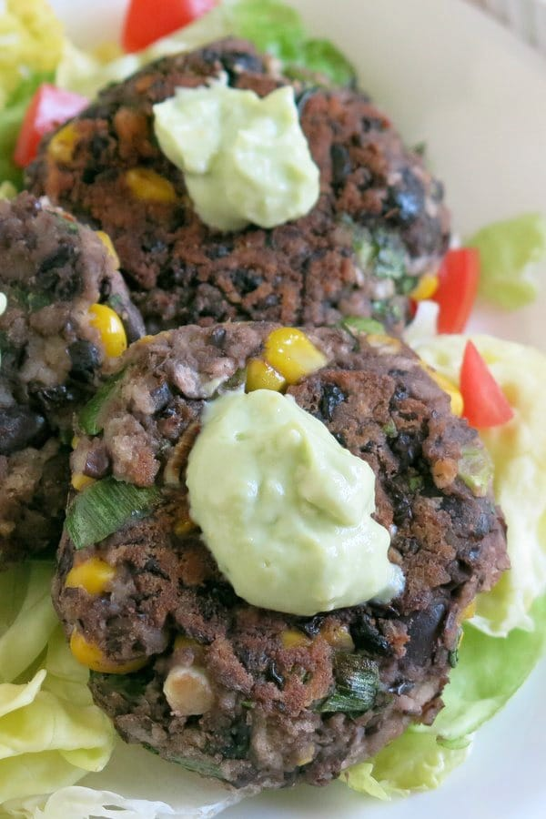 Black Bean Cake Recipe with Avocado Cream on plate