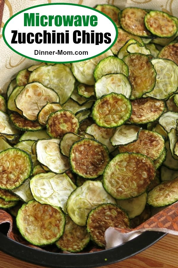 You don't have to wait hours to enjoy this healthy snack..make Zucchini Chips in the microwave. Tips for crispy chips kids and low-carb dieters will love! #zucchinichips #healthysnack