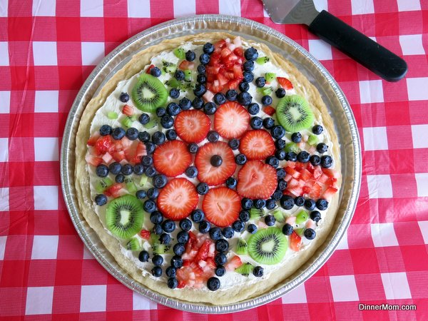 Fruit Pizza with Cream Cheese Frosting topped with kiwi, blueberries and strawberries