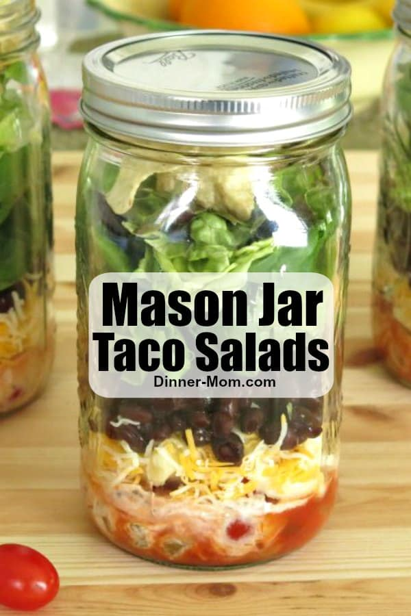Make Mason Jar Taco Salads with an easy 2 ingredient salsa dressing and every day can be Taco Tuesday! #tacosalad #saladrecipes