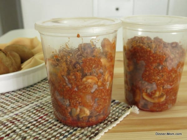 Two containers of sloppy joes sauce ready to go in the freezer
