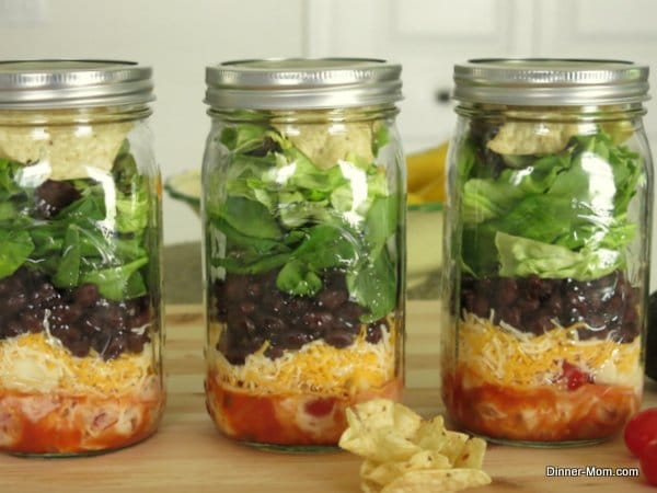 3 full Layered Taco Salads in Jars in a row
