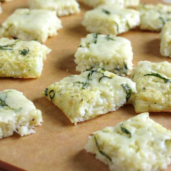 Small rectangle Cauliflower Pizza Bites on a cutting board