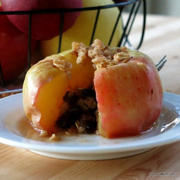 Microwave Baked Apple sliced open on a plate.