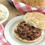 Slow Cooker Pulled Pork Tenderloin in Blackberry BBQ Sauce on a bun
