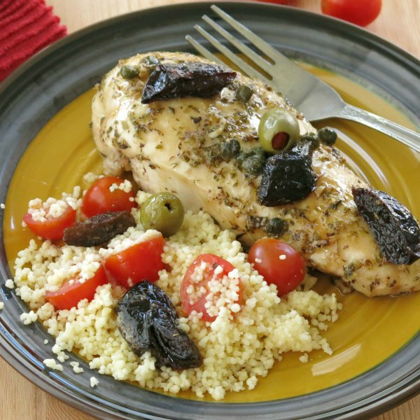 Chicken Marbella Boneless chicken with prunes and olives on plate