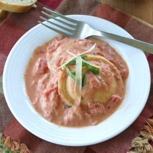 Easy Tomato Cream Sauce over Ravioli in a bowl with a fork