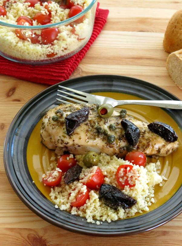 Chicken Marbella boneless chicken on plate with couscous and fork
