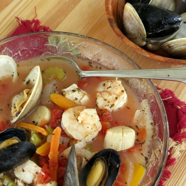 Seafood Cioppino Stew in bowl with spoon
