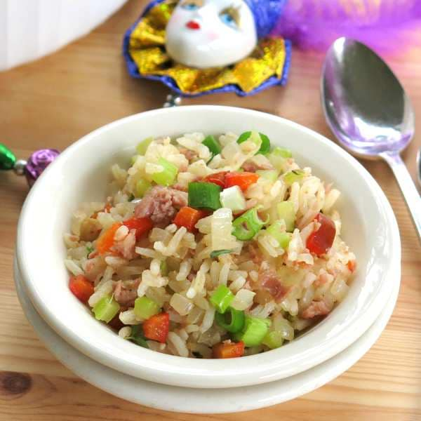 Mardi Gras Side Dish of Cajun Rice with spoon and beads showing