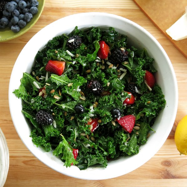 Massaged Kale Salad in bowl with berries