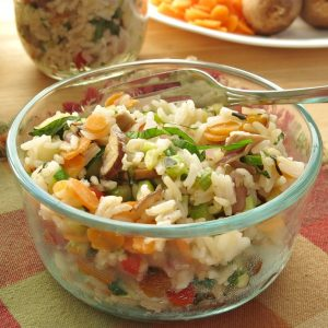 Vegetable Rice Pilaf Recipe in glass bowl with fork