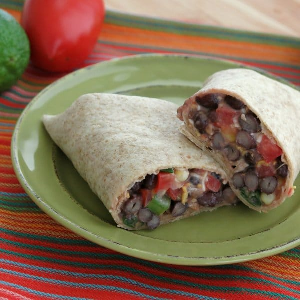 Spicy black bean wraps are filled with beans, cheese, more goodies and ...