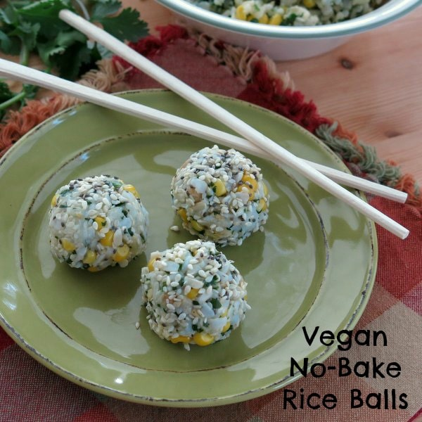 3 Vegan Rice Balls with Corn and Cilantro on plate with chop sticks