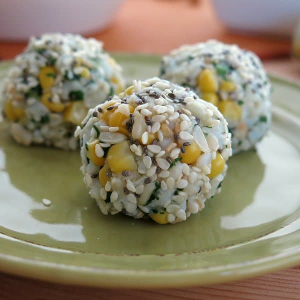 Close view of a Vegan Rice Ball with Corn and Cilantro Pesto