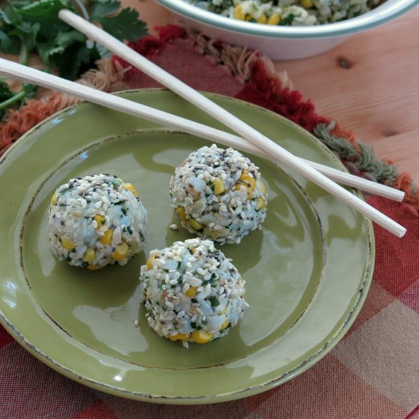 3 Vegan Rice Balls with Corn and Cilantro Pesto on a plate