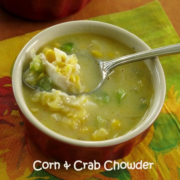 Spoon lifiting Corn and Crab Chowder out of bowl