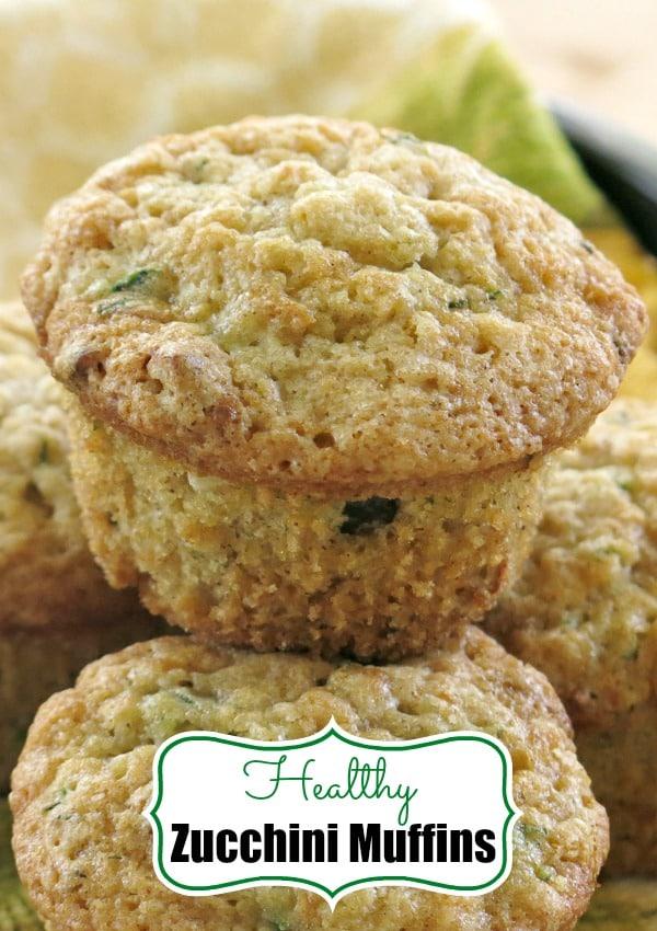 Zucchini Muffins - Healthy, easy recipe uses Greek yogurt instead of oil and whole wheat flour! #zucchini #muffins