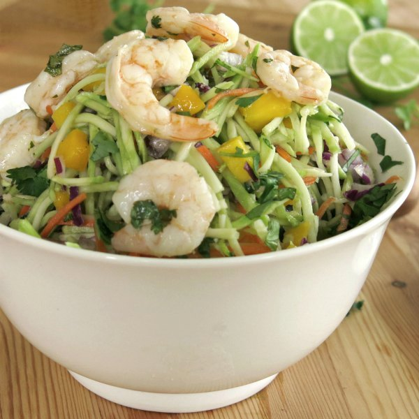 Easy Margarita Shrimp and Slaw in a bowl with limes in the background