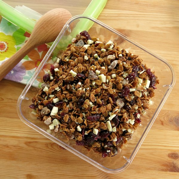 Homemade Granola in a square container with a spoon next to it