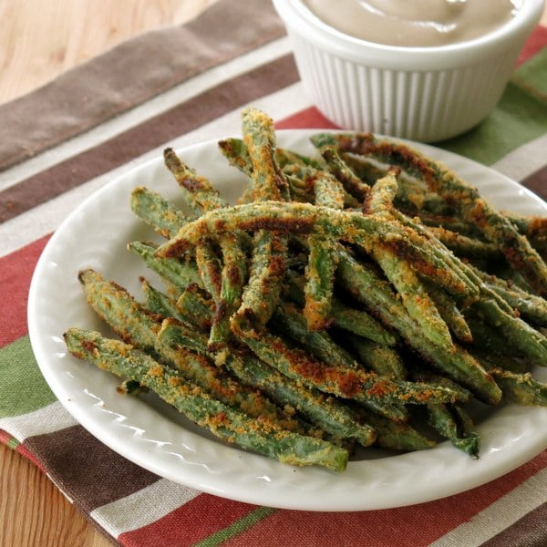 Crispy Baked Green Bean Fries on a plate and Balsamic Yogurt Dip