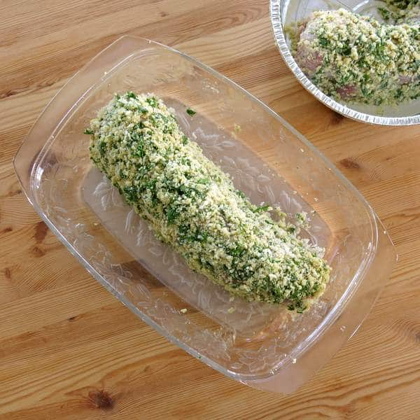 Uncooked Herb Crusted Pork Tenderloin in baking dish