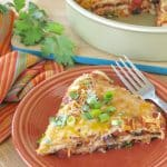 slice of burrito pie casserole on plate with fork