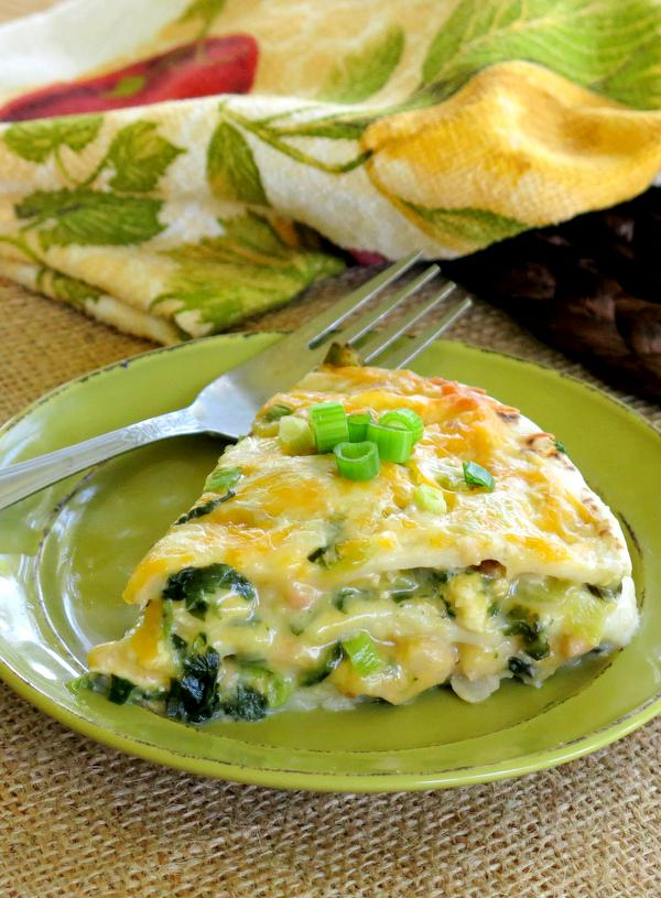 Slice of Easy Chicken Enchilada Pie Recipe on place with fork