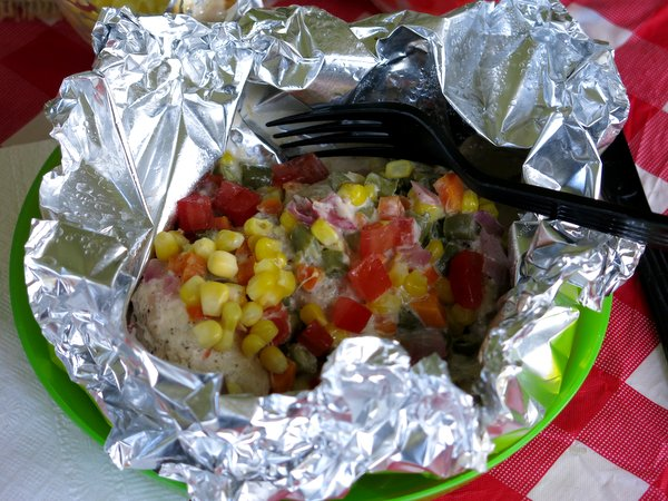 Open foil packet with Spicy Ranch Chicken Grilled and Confetti Vegetables inside