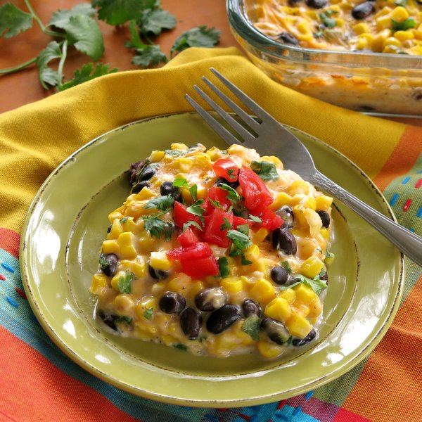 Tex Mex Cheddar Corn Casserole Recipe on plate with a fork next to it