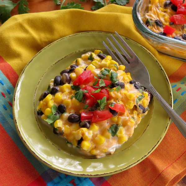 Overhead shot of Mexican Cheddar Corn Casserole Recipe with fork on plate