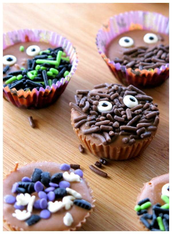 Easy Almond Butter Fudge decorated with eyes and halloween sprinkles in mini paper inserts.