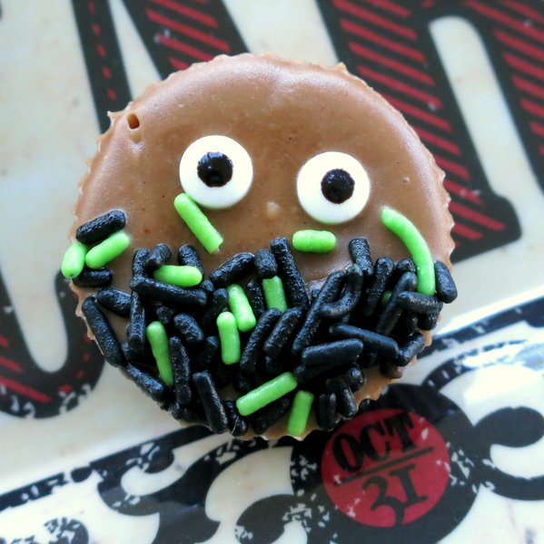 Piece of easy almond butter freezer fudge decorated for Halloween with eyes and sprinkles.