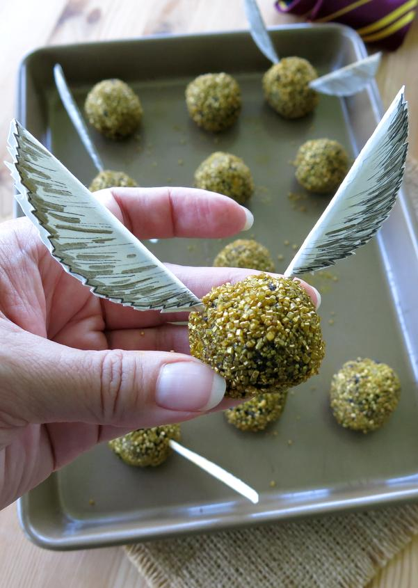 This 3 Ingredient Harry Potter Golden Snitch Truffles recipe gets the approval of the Quidditch team. Easy to make edible balls and paper wings.